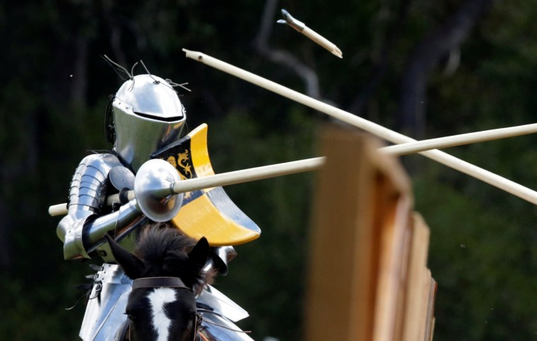Image: Australian jouster Luke Binks has a lance break off his body during the jousting tournament at the St Ives Medieval Fair in Sydney