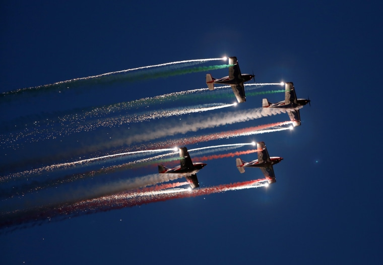 Image: The Pioneer Team, a civil aerobatic team from Italy, let off pyrotechnics from their Pioneer 330 aircraft during the Malta International Airshow