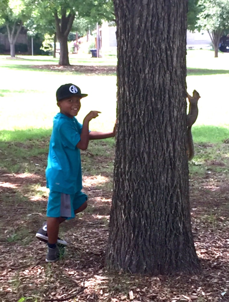 Brylan with a living squirrel.