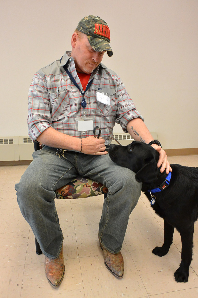 John Welch, and his service dog, a black lab named Onyx.