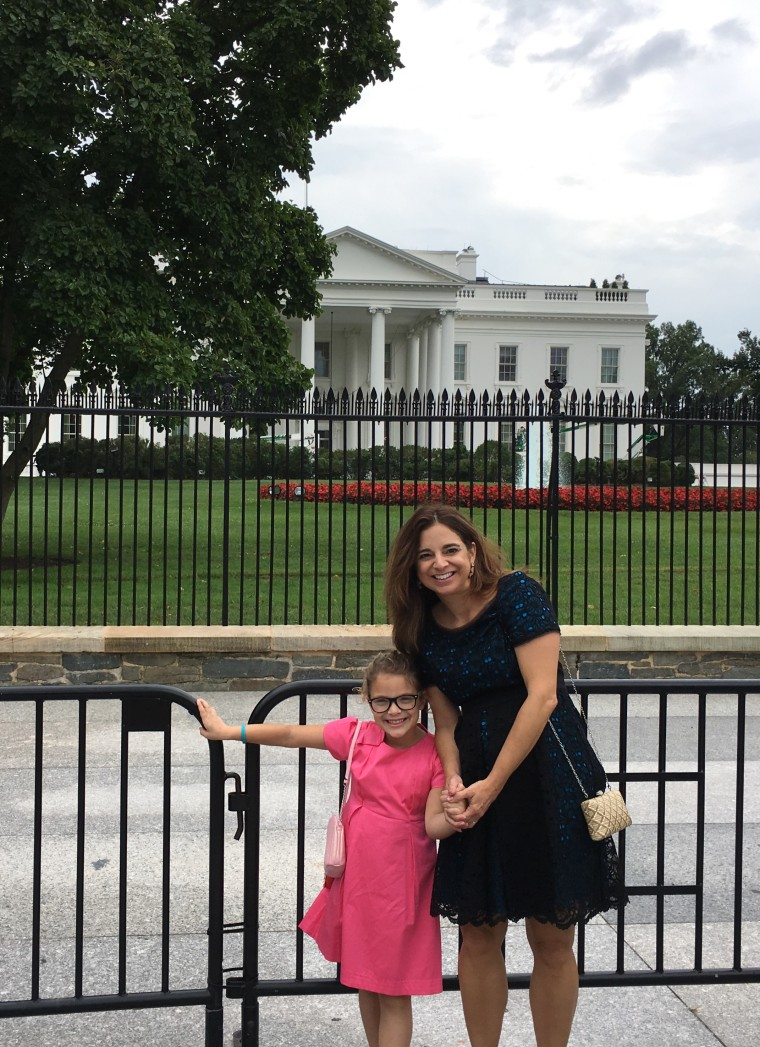 Cathy Areu, political pundit and ardent Democrat, with her 7-year-old daughter in front of the White House on a recent visit to Washington, D.C.