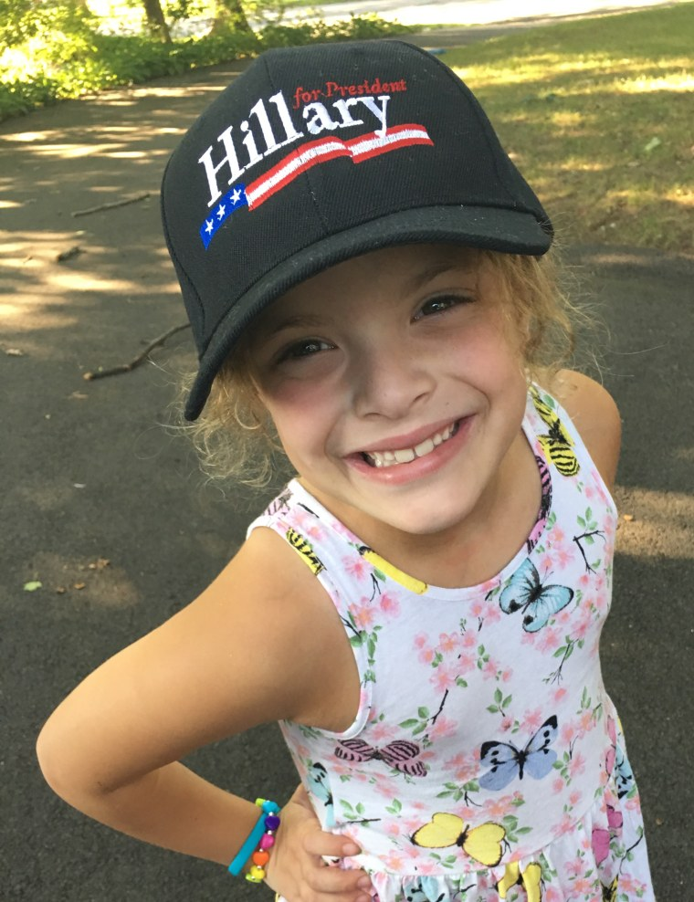 I'm with her! ... My mom, that is. Cathy Areu's daughter poses in a new hat that aligns with her politics. But trying to raise political mini-mes can backfire, Cathy discovered.