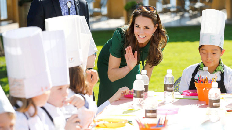 Catherine, Duchess of Cambridge, talks with children during the Taste of British Columbia event
