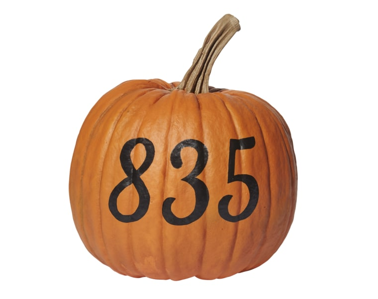 Let trick-or-treaters know where they are with this DIY numbered pumpkin.