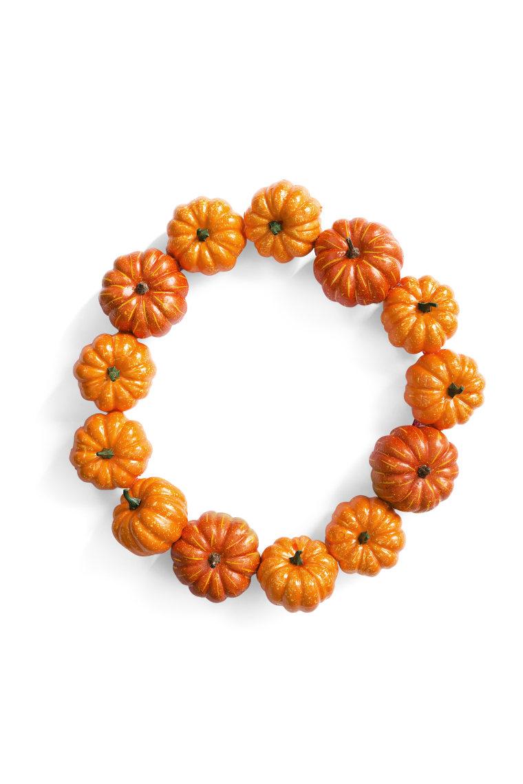 Make your front door festive with this pumpkin wreath.