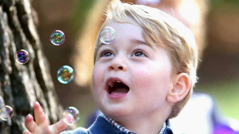 Prince George watches as bubbles are blown at a children's party at Government House in Victoria