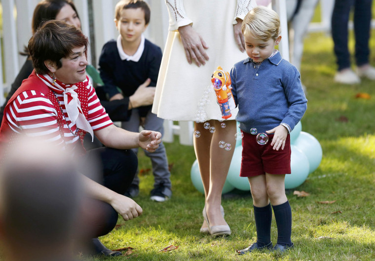 Prince George plays with a bubble gun at a children's party at Government House in Victoria