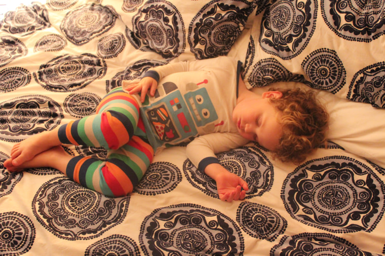 """Christina Geist's new children's book, """"Buddy's Bedtime Battery,"""" is based in part on Christina and Willie Geist's experiences putting their own children to bed. Here, their little Ro-Buddy catches some Zzzzs."""