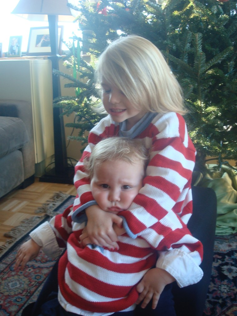 Awww, sisterly (and brotherly) love! Lucie and George Geist share a hug.