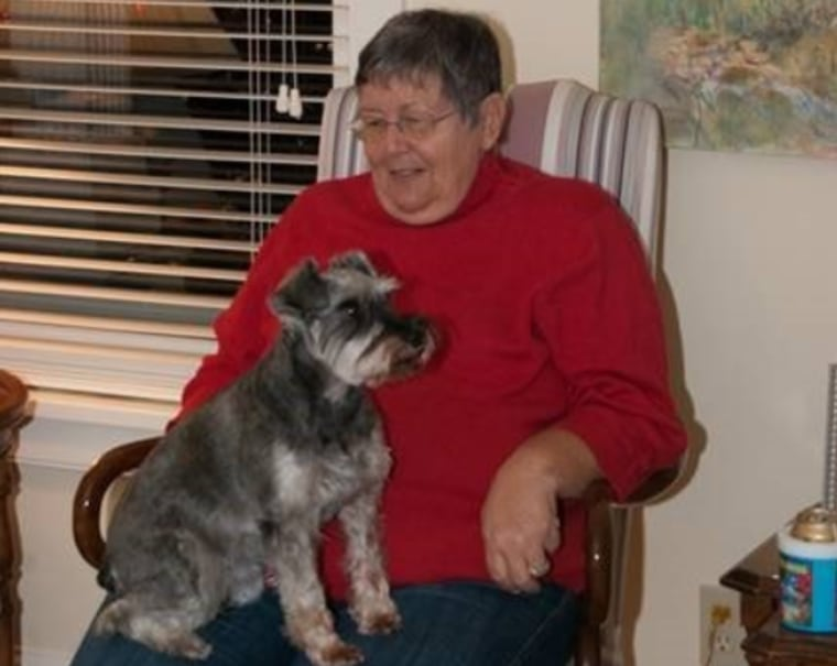 Louann VanKoevering is pictured with one of her miniature schnauzers.