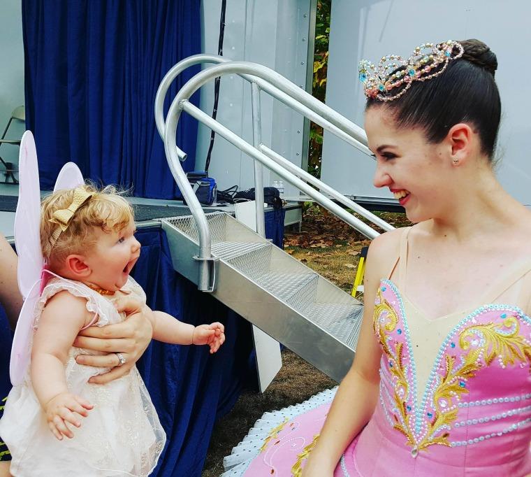 Stella Schwendeman, then 5-months old, reacts to meeting 14-year-old ballerina Abigail Cowan.