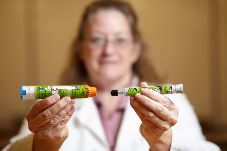 Image: Dr. Julie C. Brown of University of Washington Medicine pediatrics/emergency medicine holding EpiPens, the new design (left) and old EpiPen (right), Monday, Sept. 19, 2016, Seattle, Washington.