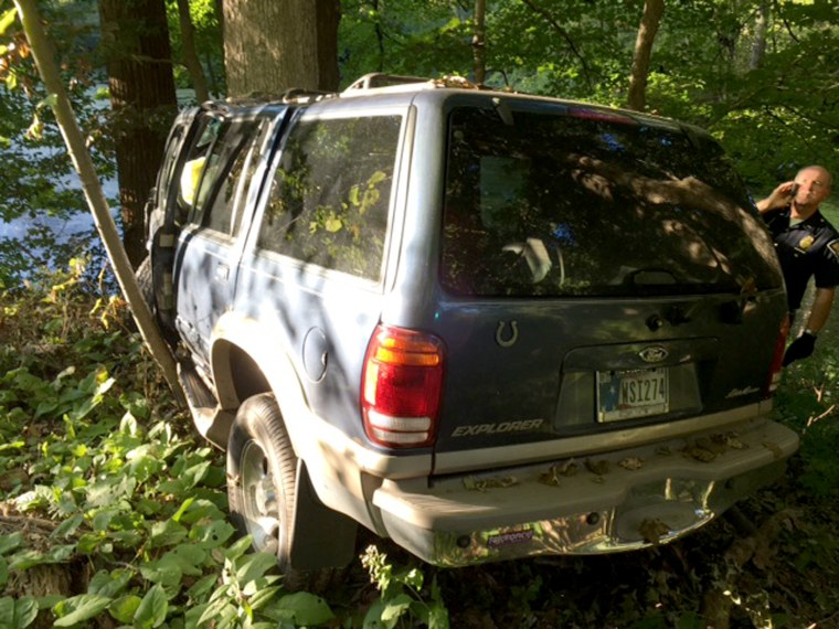 This photo released by Indiana State Police shows the vehicle that crashed in Indiana Saturday, Sept. 17, 2016, killing one person and leaving another man trapped inside.