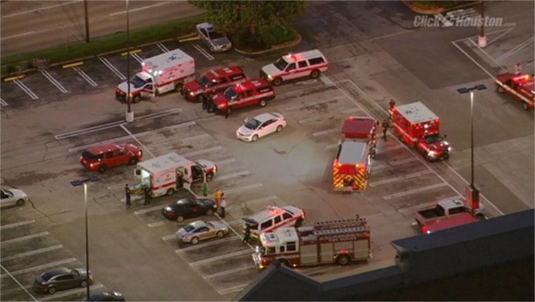 Image: Police activity near a shopping center Monday morning in southwest Houston