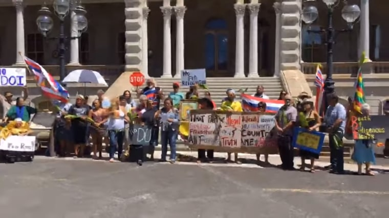 Native Hawaiian sovereignty activists protesting a Department of Interior rule outside of the Iolani Palace in Honolulu, Hawaii