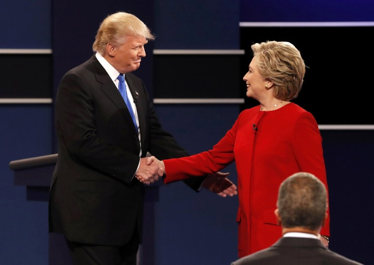 Image: Republican U.S. presidential nominee Donald Trump shakes hands with Democratic U.S. presidential nominee Hillary Clinton at the start of their first presidential debate at Hofstra University in Hempstead