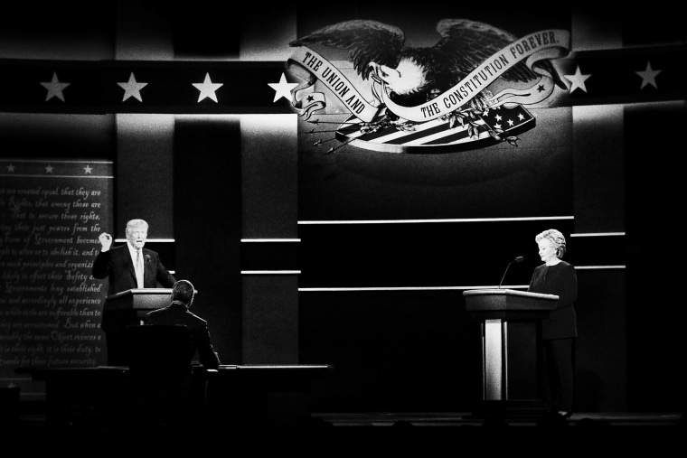 Republican presidential nominee Donald Trump and Democratic presidential nominee Hillary Clinton answer questions during the first presidential debate.