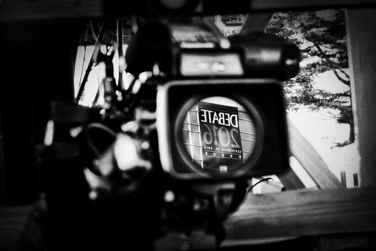 A sign outside of Hofstra University is reflected in a TV camera lens.