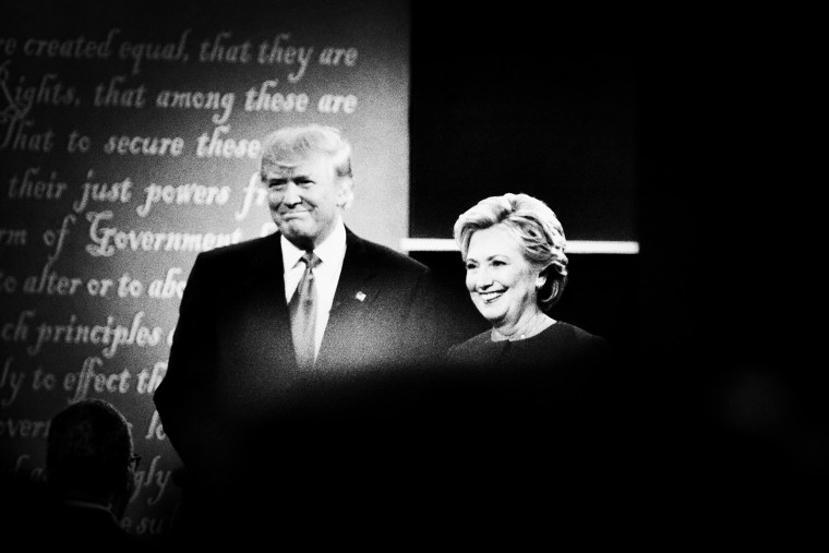 Republican presidential nominee Donald Trump and Democratic presidential nominee Hillary Clinton arrive on stage for the first presidential debate.