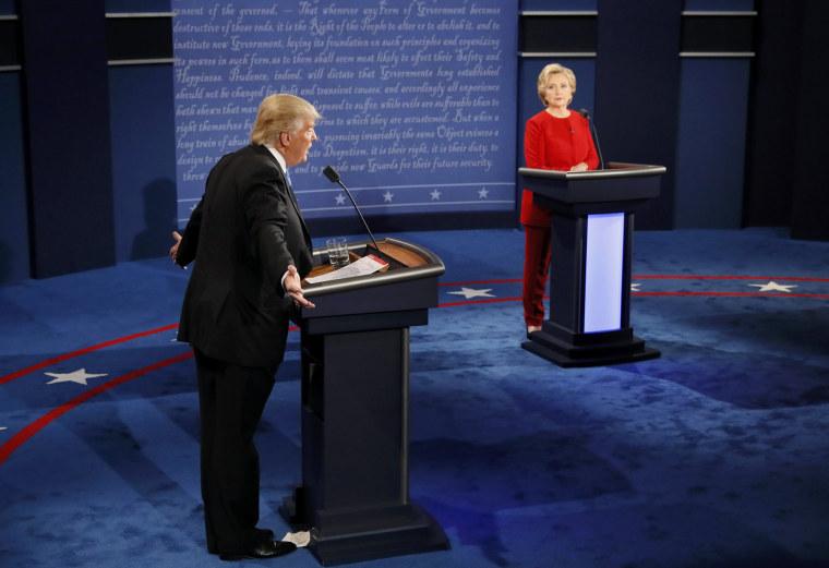 Image: Republican U.S. presidential nominee Trump speaks as Clinton listens during presidential debate at Hofstra University in Hempstead