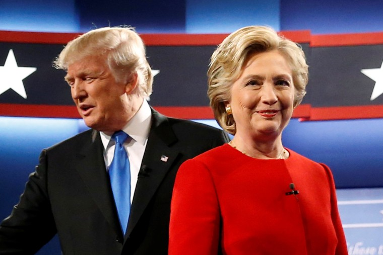 Image: Trump and Clinton greet one another as they take the stage for their first debate at Hofstra University in Hempstead, New York, U.S.