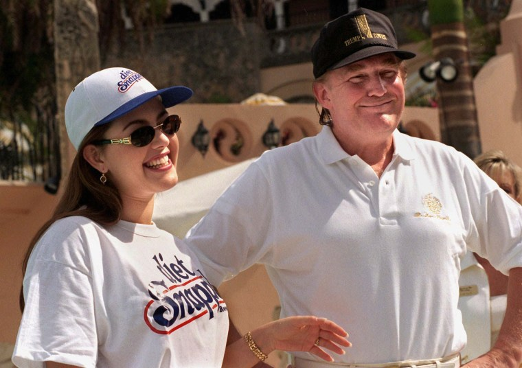 Image: Alicia Machado appears with Donald Trump in Feb. 1997