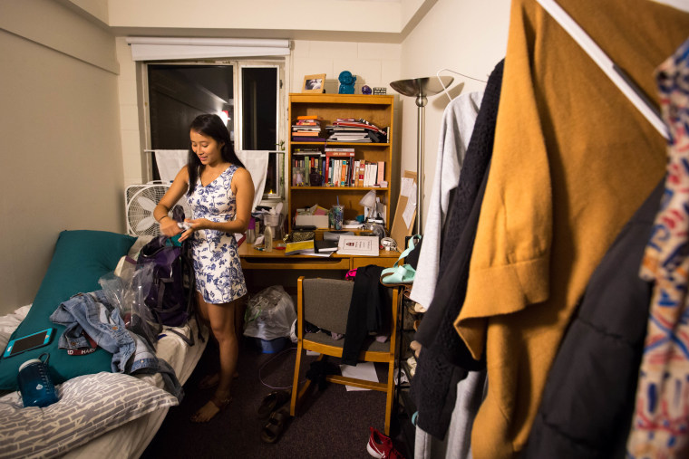 Nadya Okamoto, an 18-year-old freshman at Harvard University, packs her backpack ahead of her 7 p.m. meeting with the Hygiene Campaign Club.