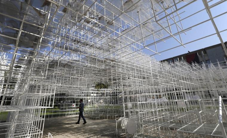 Image: Visitors at art work The Cloud by Japanese artist Sou Fujimoto in Tirana