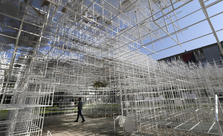 Image: Visitors at art work The Cloud by Japanese artist Sou Fujimoto in Tirana