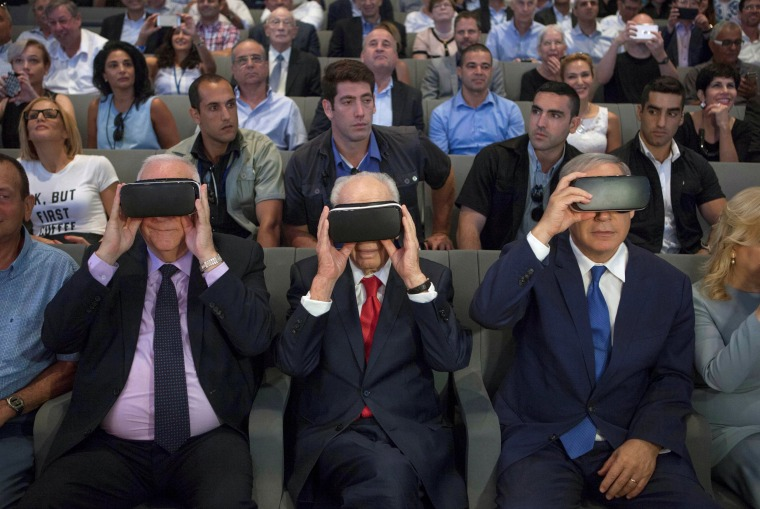 Image: Rivlin, Peres and Netanyahu wear virtual reality goggles during a ceremony at the Peres Center for Peace in Jaffa