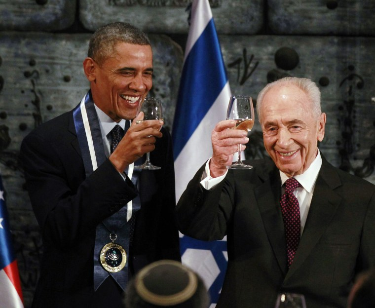 Image: U.S. President Barack Obama toasts with Israel's President Shimon Peres after Obama was presented with the Presidential Medal of Distinction, Israel's highest civilian honor in Jerusalem
