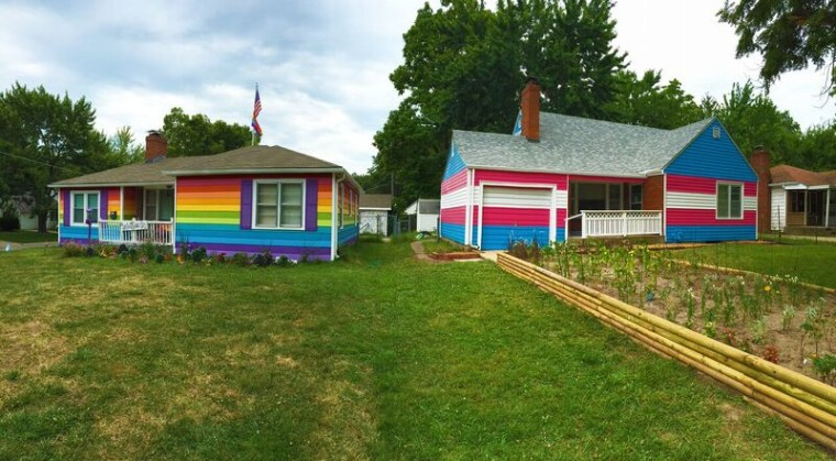Equality House (left) and the Trans Pride house (right) sit across the street from the Westboro Baptist Church in Topeka, Kansas.
