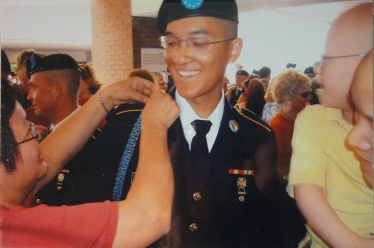 Danny Chen's mother, Su Zhen Chen, fixing his cord in Fort Benning, Georgia, in April 2011.