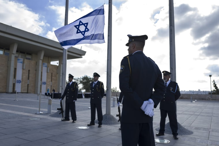 Image: Knesset in Jerusalem lowers flags to half mast honoring Shimon Peres