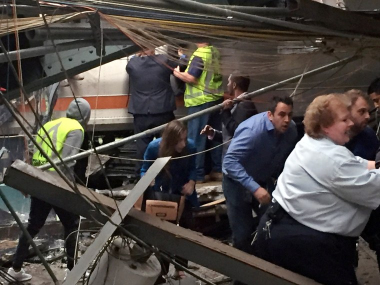 Image: Passengers rush to safety after a NJ Transit train crashed into the platform at the Hoboken Terminal