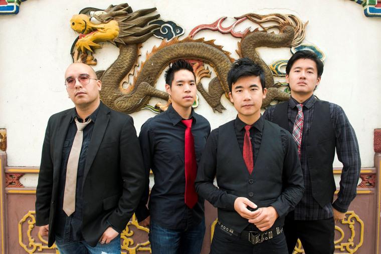 Image: Members of the Portland, Oregon-based Asian-American rock band The Slants pose