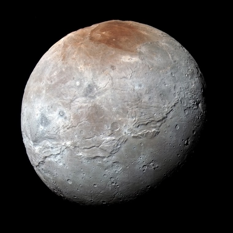 Image: Pluto???s largest moon, Charon, is seen in a high-resolution, enhanced color view captured by NASA's New Horizons spacecraft