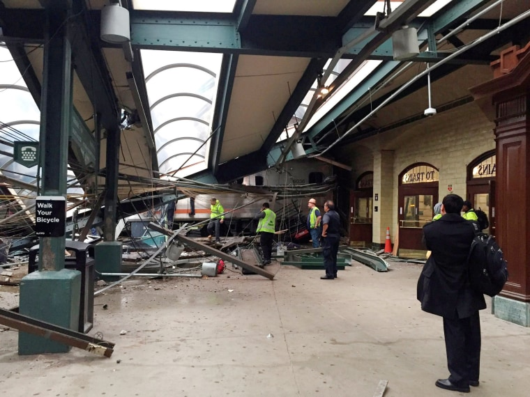 Image: A New Jersey Transit train that derailed and crashed through the station is seen in Hoboken, New Jersey