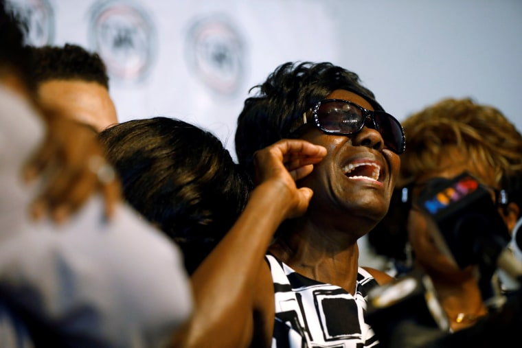 Image: Pamela Benge, mother of Alfred Olango, speaks as the family of Alfred Olango, who was shot by El Cajon police Tuesday, gathers at a news conference in San Diego, California