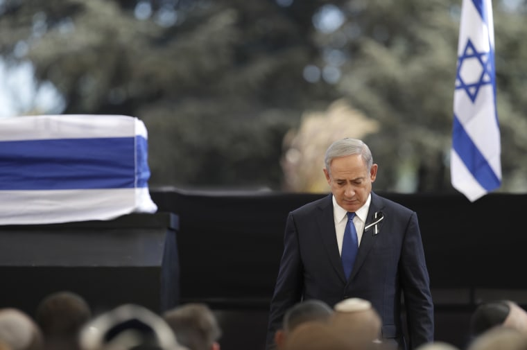 Image: Benjamin Netanyahu walks past the casket of Shimon Peres at Mount Herzl national cemetery, Friday.