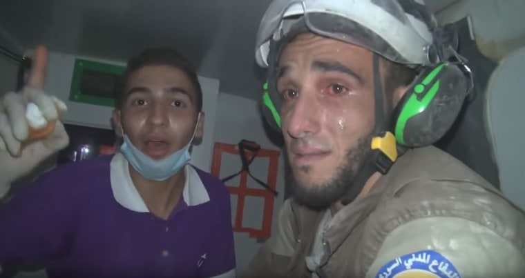 Image: A White Helmets volunteer breaks down in tears after an hours-long operation to rescue a baby in the Idlib province in Syria
