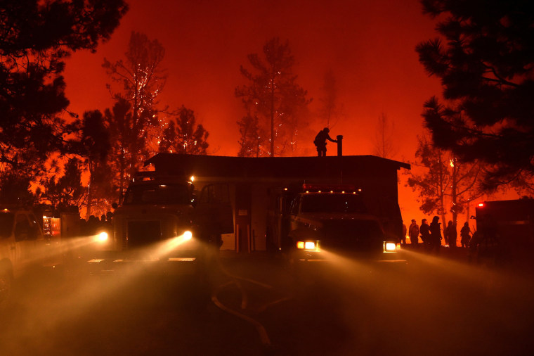 Image: Firefighters attempt to save the Casa Loma fire station in the Santa Cruz Mountains near Loma Prieta, Calif.