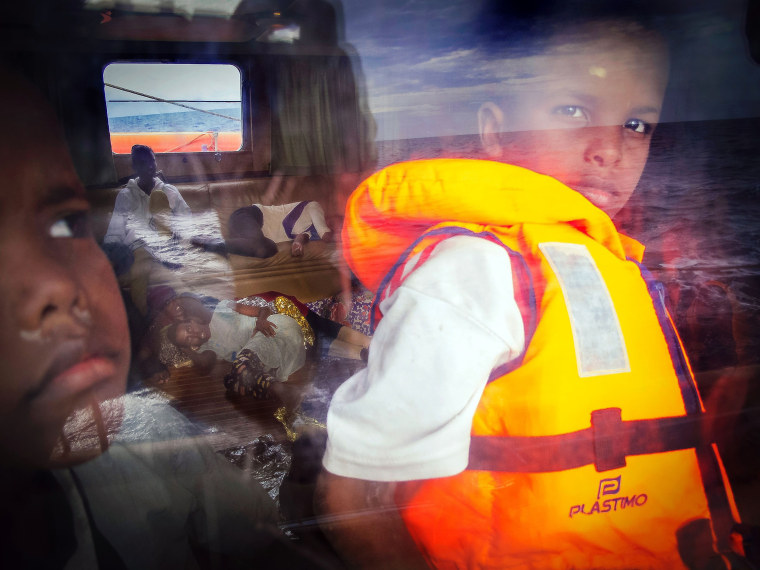 Image: Eight-year-old Samir from Somalia looks out of the window of the Astral rescue ship