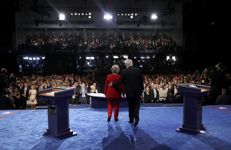 Image: Clinton and Trump at the conclusion of their first presidential debate at Hofstra University in Hempstead