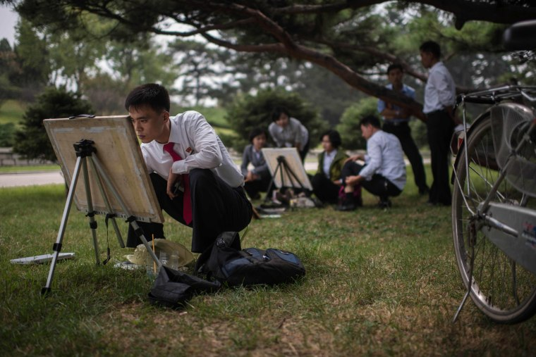 Image: North Korean students take part in a painting workshop in a park in Pyongyang