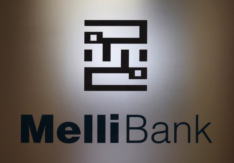 A company logo of Bank Melli is displayed on the glass door at its branch in Hong Kong