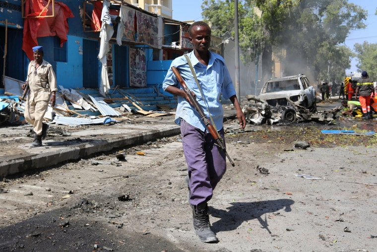 Image: Somali government soldiers secure the scene of an attack on a restaurant by the Somali Islamist group al Shabaab in the capital Mogadishu