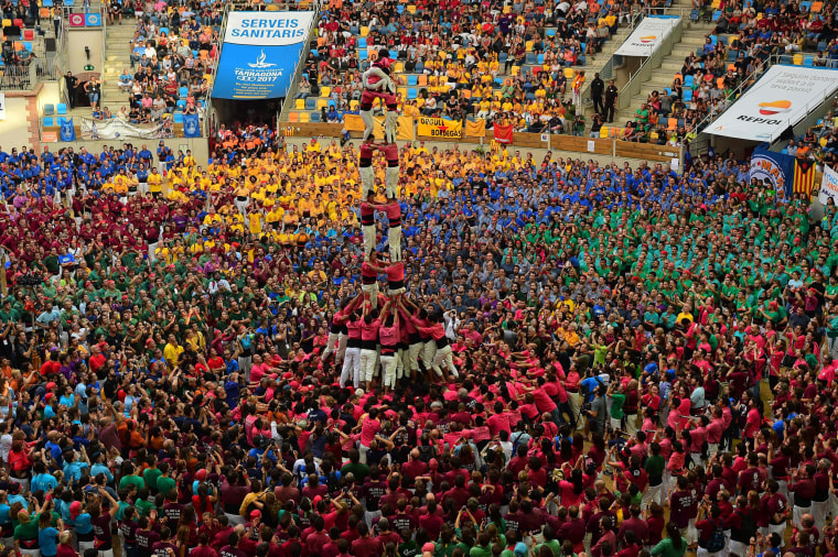 Image: TOPSHOT-SPAIN-CATALONIA-HUMAN-TOWERS-CASTELS