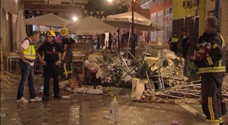 Image: Police and rescue services are pictured at the scene after a gas cylinder exploded in a cafe in Velez-Malaga