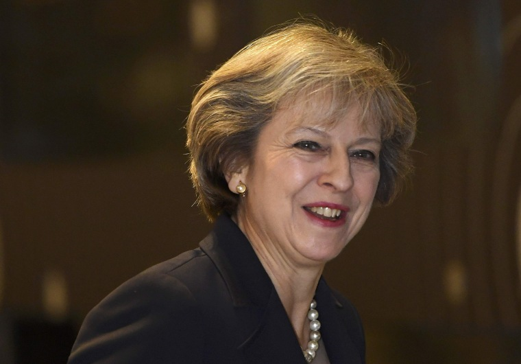 Image: Britain's Prime Minister May arrives at a television studio during the annual Conservative Party Conference in Birmingham, Britain
